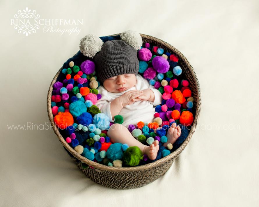 Adorable baby portrait with pom poms
